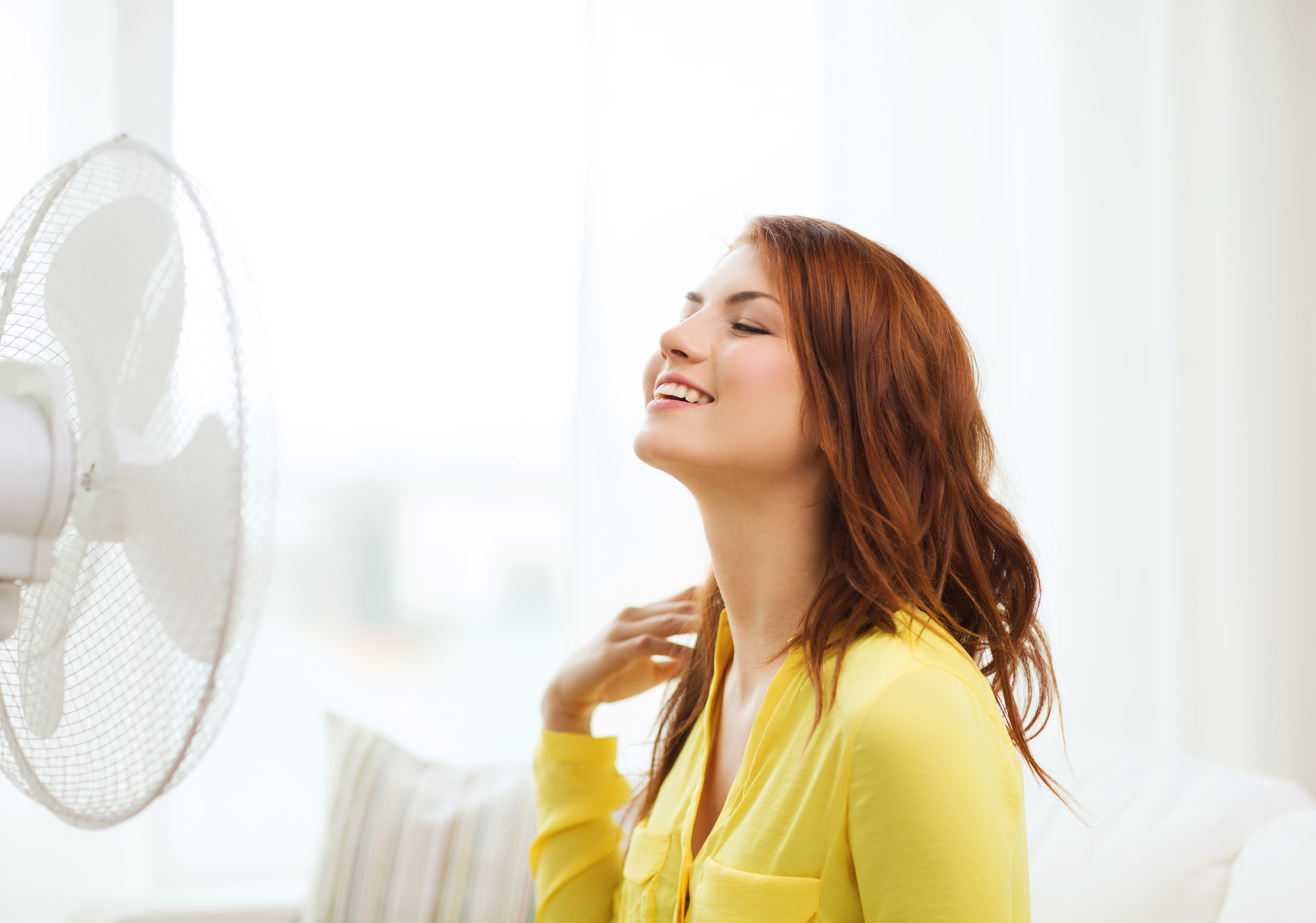 Smiling girl in front of a fan | Daikin UAE